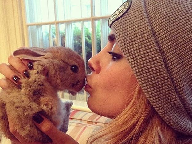 Model Cara Delevigne with Cecil the bunny.