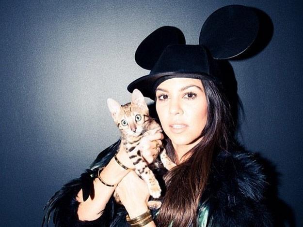 Kourtney Kardashian and her sweet little kitty cat.