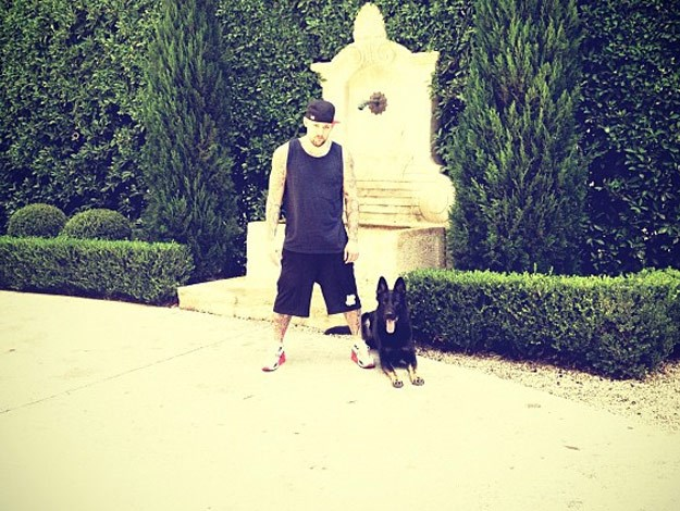 Joel Madden poses with the family pet.