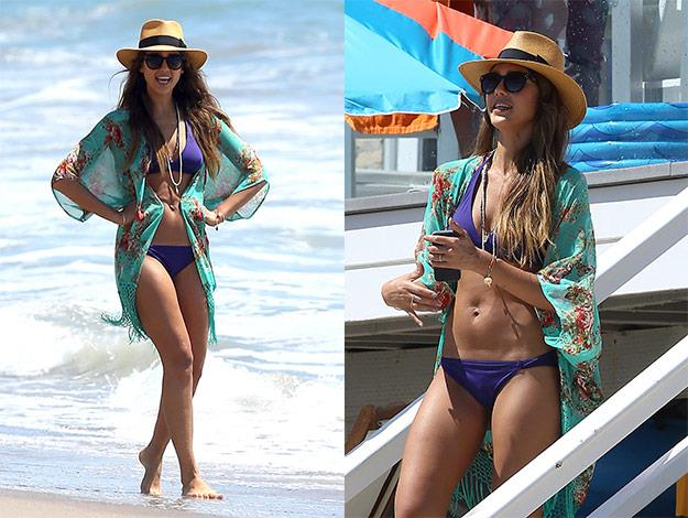 The mother-of-two looks smoking hot in a purple bikini.