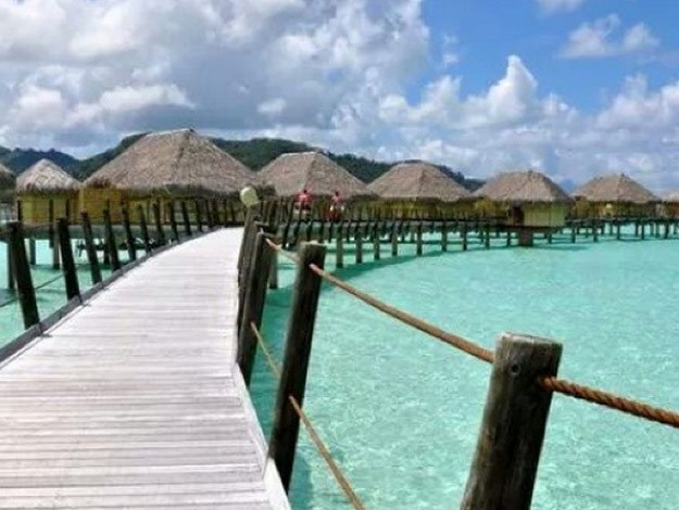 Each of the villas open onto the white sand beach and the turquoise lagoon.