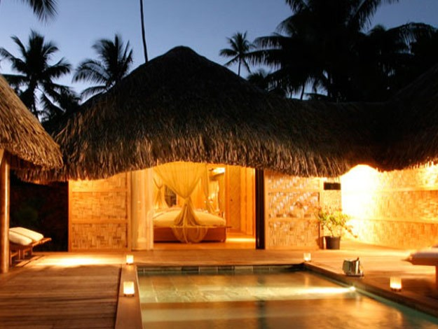 The royal beach villas feature a plunge pool and thatched roof gazebo.