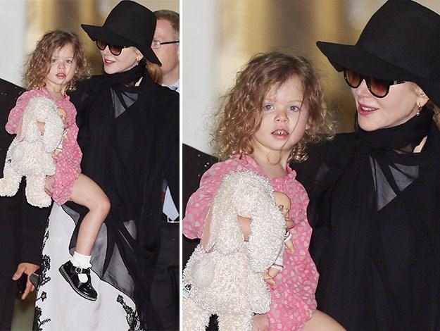 Nicole carries Faith through Sydney airport.