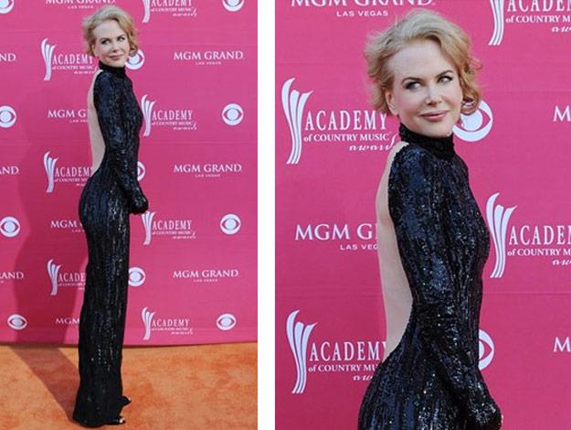 Keeping things classy, Nicole wears an L'Wren Scott open Back dress. Wow!