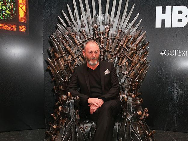 Liam Cunningham, aka Davos Seaworth, looks right at home as he reclines on the iron throne