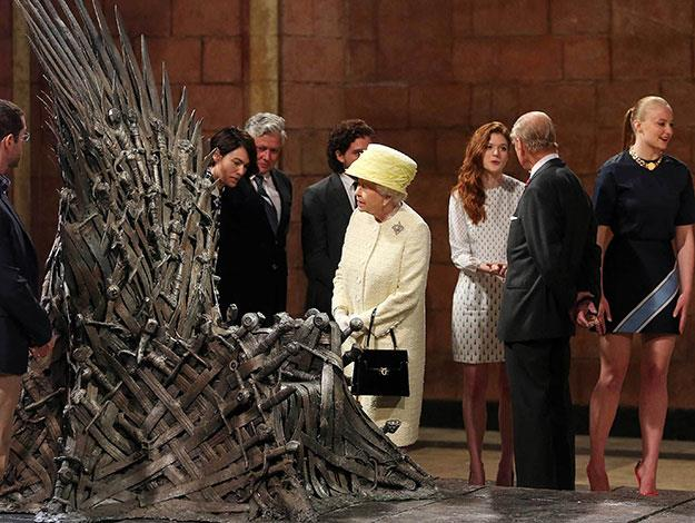 Queen Elizabeth examined the iron throne alongside cast members including Lena Headey, Kit Harrington and Sophie Turner in Northern Ireland when the exhibition toured there