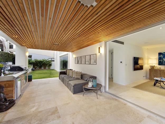 Indoor merges with outdoor in this covered barbecue area