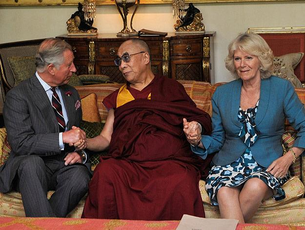 Prince Charles and Camilla sit and chat to the Dalai Lama.