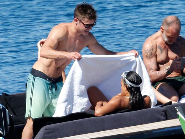 Affectionate Zac hands Michelle a towel after she gets out of the water.