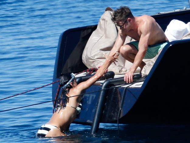 Lending a helping hand: Zac helps Michelle out of the water.