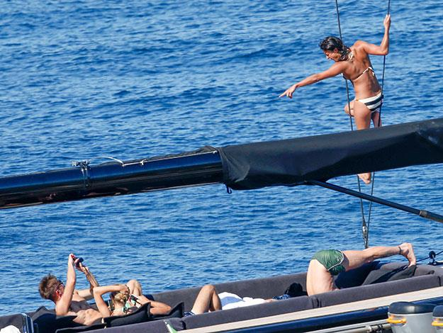 Zac snaps a photo as Michelle shows off her courage and climbs the ropes of the yacht.