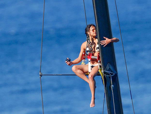 Michelle climbs all the way up the mast of the yacht to snap some pics.