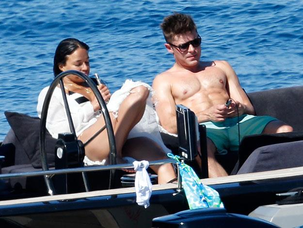 Zac and Michelle recline together in the hot sun.