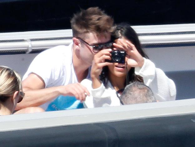 Zac and Michelle turn the camera on the photographers as they snap some vacation snaps of their own.
