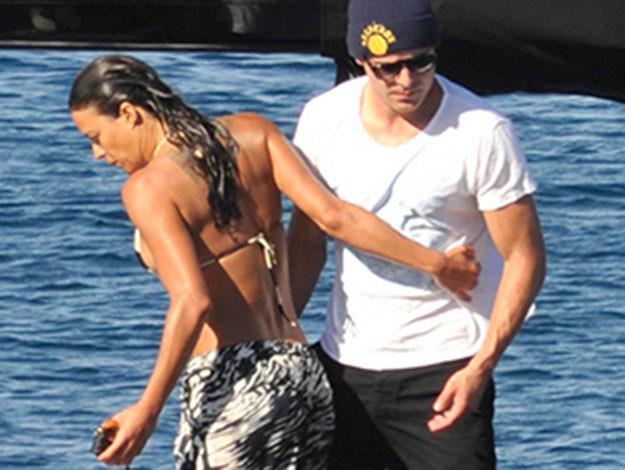 Michelle shows affection for Zac, as the pair touch each other onboard the boat.