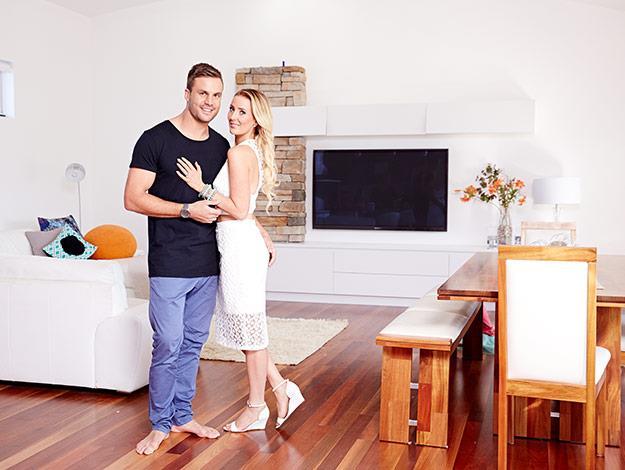 Beau and Kara pose inside their stunning South Coast home.