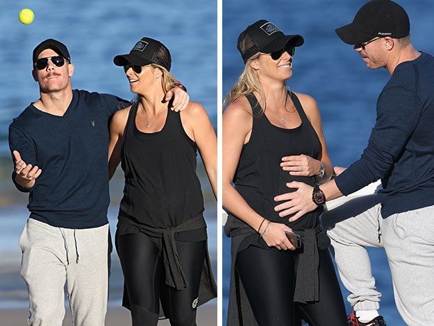 Cricketer David tossed a ball around as they went for a stroll, stopping occasionally to proudly feel Candice's bump.