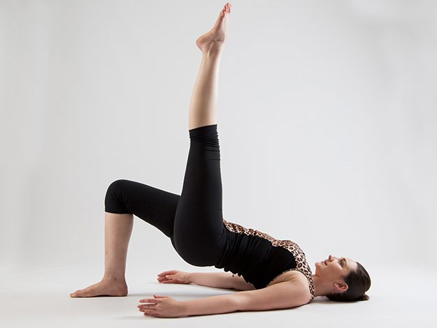 Bridging with leg pulse  Areas targeted: Bottom and backs of the legs  Perform 20-30 pulses each side  1. Come into a bridge position to begin this exercise.  2. As you inhale begin to lift one leg to tabletop and straighten it with the toe pointed towards the ceiling.  3. Inhale to lower the hips 4 inches and exhale to squeeze through the glutes and press the hips back to the start position. You will perform slow controlled pulses making sure you squeeze the bottom to lift the hips.