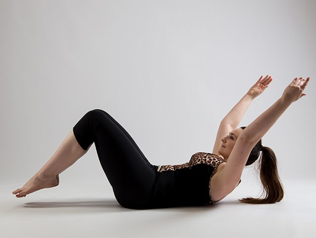 Double leg lowers  Areas targeted: Abdominals  Perform: 6-10 times  1. Start lying on your back with the arms reaching to the ceiling and the legs in tabletop with the inner thighs squeezing together.  2. Inhale to prepare and curl up with the head, neck and shoulders. Press the arms down so they are alongside the body. This is your start position.  3. As you exhale, move from the thighs as you tap the toes to the floor and reach the arms up to the ceiling and slightly behind you. Ensure the head, neck and shoulders stay lifted through this movement.  4. Inhale to return back to the start position keeping the head lifted.