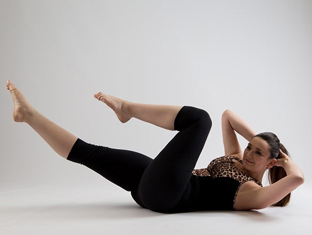 Criss Cross  Areas targeted: Abdominals and obliques  Perform 8-10 times each side alternating  1. Interlace the fingers and place the hands behind the head. Imprint the lower back into the mat and lift the legs one at a time to tabletop.  2. Inhale to prepare and curl up into a chest lift position to begin the exercise.  3. Exhale to twist the upper body towards the left, taking the right elbow towards the left knee and allow the right leg to straighten.  4. Inhale to bring the legs back to tabletop and the body through centre. Breathe out to twist to the other side. Feel as you twist that you connect the opposite armpit to the opposite hipbone and avoid losing the height of your chest lift as you come through centre.
