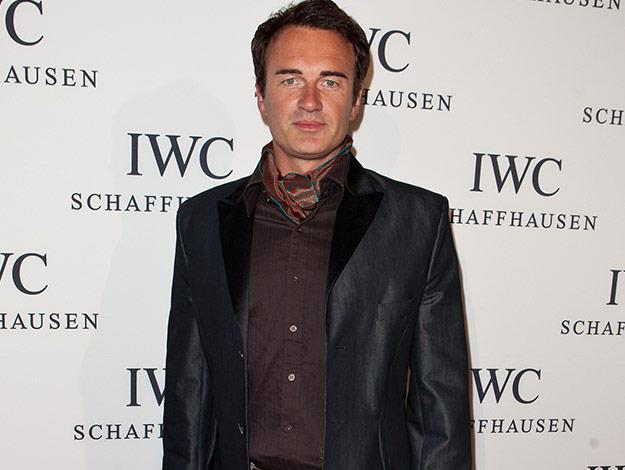 Julian McMahon  It's hard to believe that Hollywood megastar Julian McMahon began his acting career on Home and Away. Since his surfing days at Palm Beach, he has earned great success from a number of acting stints, including his portrayals of Cole Turner in the hit series Charmed and as womanizing plastic surgeon, Christian Troy on Emmy and Golden Globe award-winning TV show Nip/Tuck.