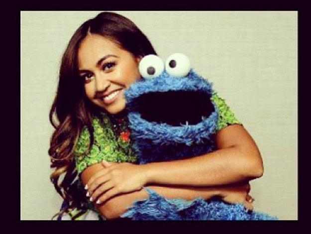 Jessica Mauboy cuddles with the Cookie Monster after an appearance on Sesame Street.