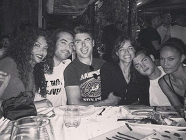 Zac and Michelle cozy up together as they are pictured with their Ibiza family.