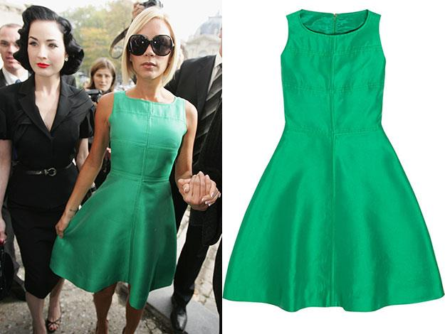 One of the dresses that will be up for auction: a green Louis Féraud dress that Posh wore to the Chanel runway show at Paris Fashion week in 2008.