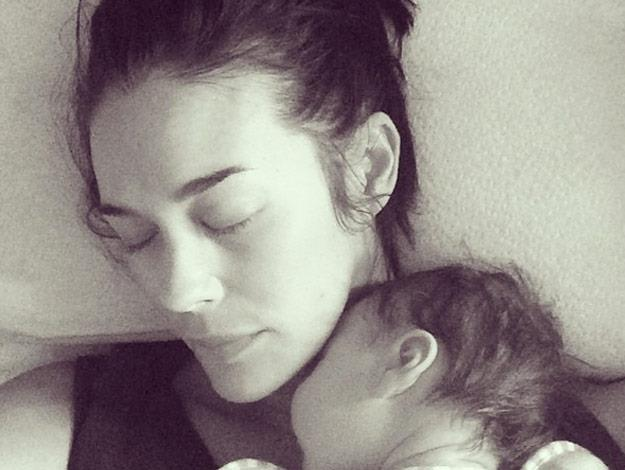 """Australian model, Megan Gale, says cuddling with her little man, River, is the """"best feeling ever!""""."""