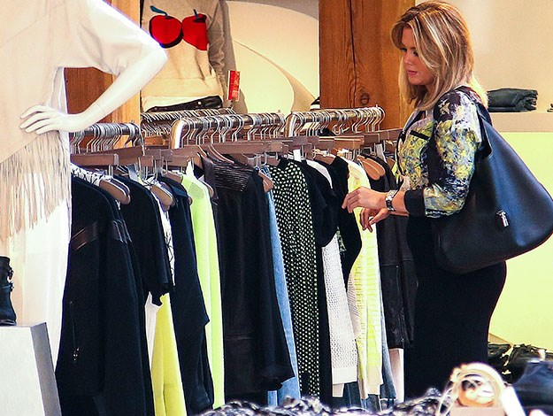 It looks like Sams outfit coordinates with the clothes on the rack too!