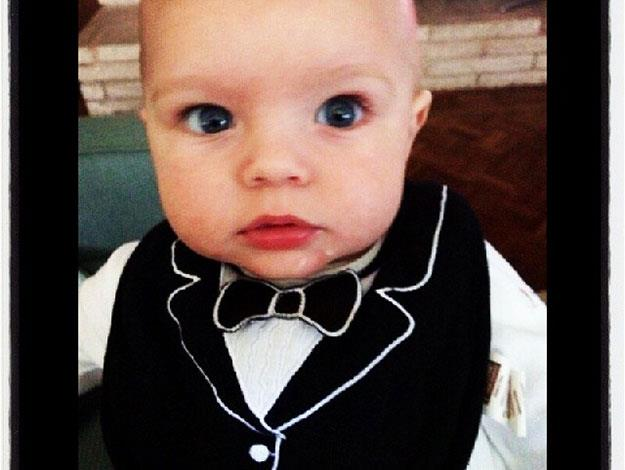 """How dashing! Proud Dad Josh captioned this snap: """"I'd like to thank the academy for this excellent bib."""""""