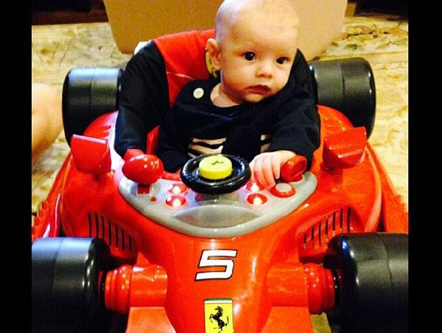 Clearly meant for big things: little Axl at two months old and already at the wheel of a Ferrari!