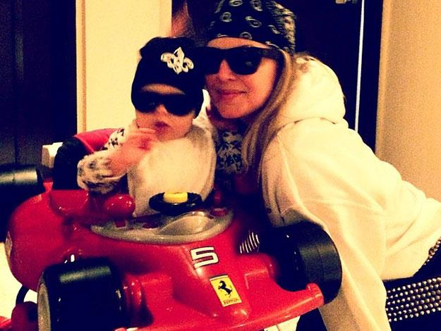 Mum Fergie teaches Axl about how to look swag while driving his Ferrari.