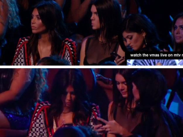 Kim Kardashian and her sisters Kendall and Kylie Jenner seemed to be caught looking bored and texting on their phones during a moment of silence at the VMAs to pay tribute to Michael Brown and the Ferguson protests. Images via MTV.