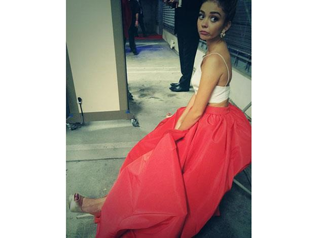 "Sarah Hyland apparently had a hard time in her heels and Life & Style reported that she sat down on the red carpet and took them off, yelling at her stylist: ""I told you they were too high."" She later tweeted this snap of herself slumming it behind the scenes as she waited for her car."