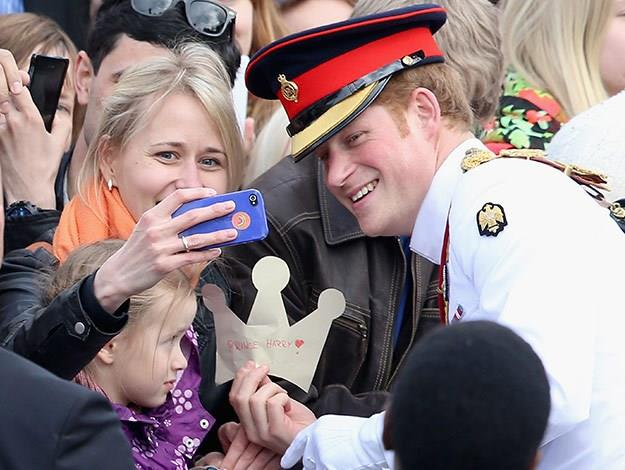Prince Harry poses for a selfie with an admiring fan in Estonia.