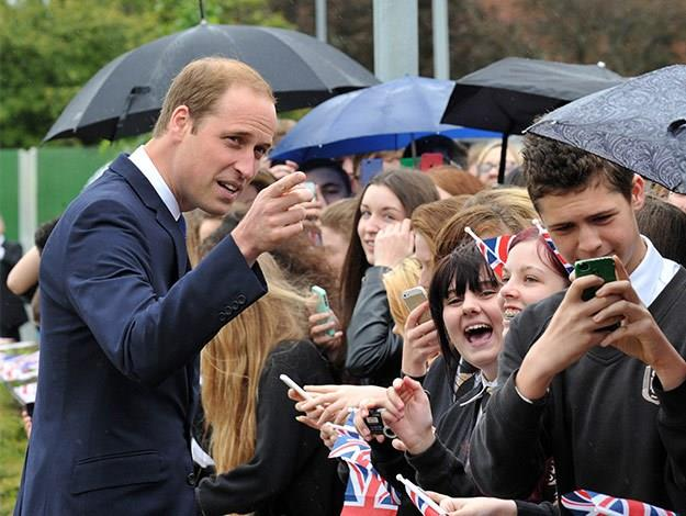 The royals are always greeted by crowds of people with their phones out wherever they go these days!