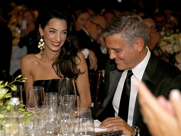 The look of love! Amal Alamuddin joins her fiance George Clooney at the 'Celebrity Fight Night In Italy.