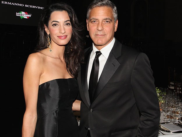 Power couple George Clooney and Amal Alamuddin pose on the red carpet together for the first time.