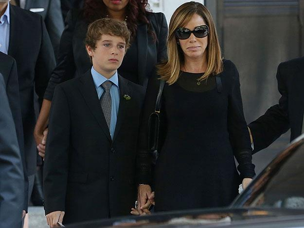 Melissa Rivers and her son Edgar stoically supported one another through their grief as they led the congregation in paying tribute to Joan Rivers at New York's Temple Emanu-El on the weekend.