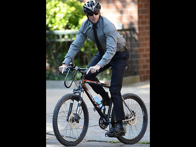 Hugh Jackman arrived at the funeral by bike and helped give Joan the big Broadway style send-off she always wanted, by performing Peter Allen's 'Quiet Please, There's a Lady on Stage' as part of his tribute to her.