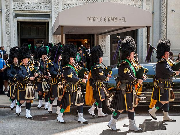 A marching band help to make Joan's funeral the grandiose affair that she would have wanted.