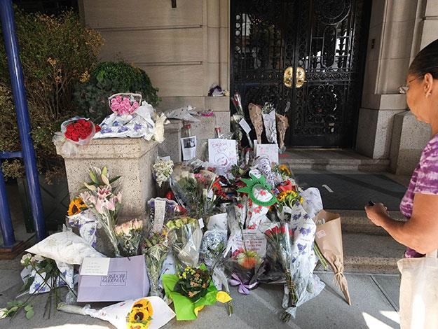 Fans paid tribute to Joan in New York by leaving bouquets and garlands outside her apartment building.