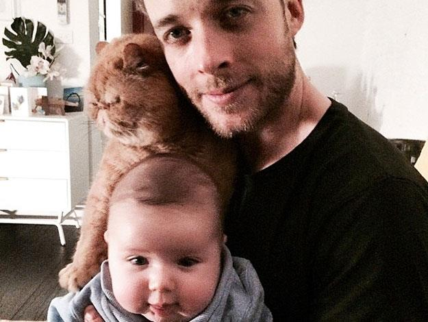"Another cute father-son (and cat) pic posted by Zoe a few weeks ago, captioned: ""My favourite boy band."""