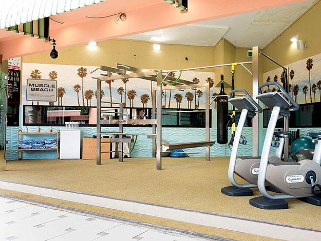 "The new ""Muscle Beach"" themed gym is under the ever-watchful eye of Big Brother."