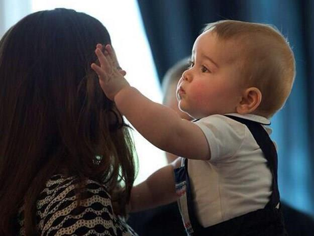 Cheeky Prince George pulls his mum's hair.