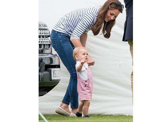 A determined Prince George walks with the help of his mum.