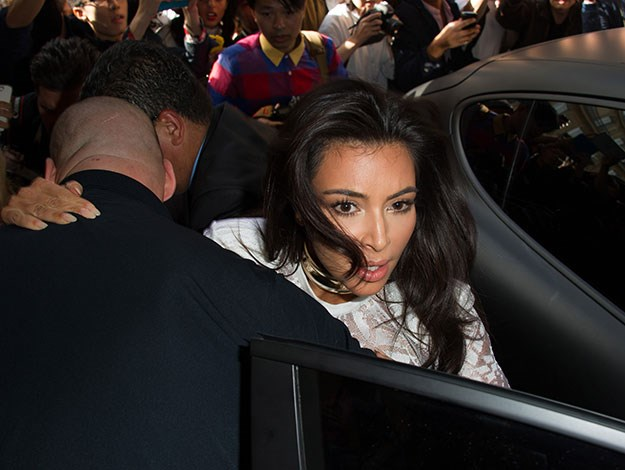 Kim Kardashian was attacked as she was grabbed and pushed by an attacker amidst a crush of people as they arrived at the Balmain fashion show.