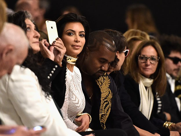 Kim and Kanye later composed themselves to sit front row at Balmain's Paris Fashion show.