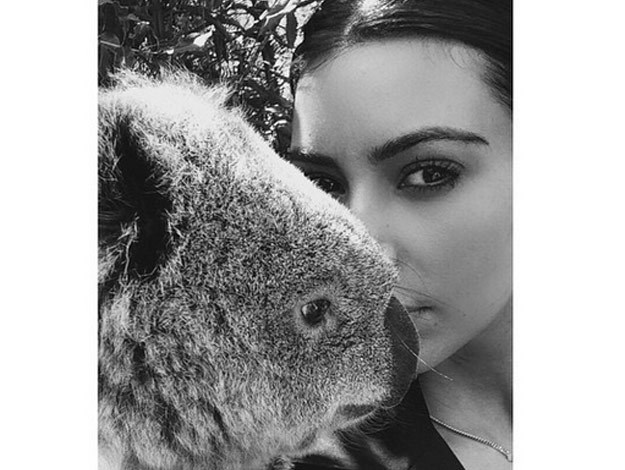 The Keeping Up With the Kardashian star snuggled up with a super-cute Koala and even managed to pose for a glamorous selfie with the warm and fuzzy creature.